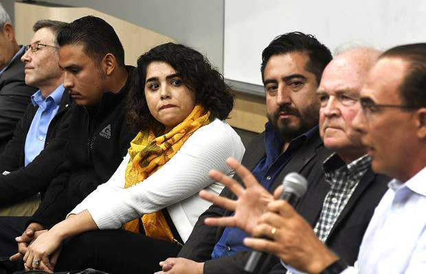 Yesenia Arreola of New Castle listens to Mark Gould speak during Tuesday's Common Ground forum on immigration at the Glenwood Springs Library. From left are Rob Stein, Junior Ortega, Arreola, Samuel Bernal, Tom Jankovsky and Gould.