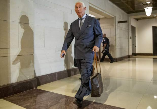 Longtime Donald Trump associate Roger Stone arrives to testify before the House Intelligence Committee, on Capitol Hill, Tuesday, Sept. 26, 2017, in Washington. Stone says there is