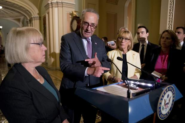 Senate Minority Leader Sen. Chuck Schumer of N.Y., accompanied by Sen. Patty Murray, D-Wash., left, and Sen. Jeanne Shaheen, D-N.H., right, speaks to reporters as Senate Republicans faced defeat on the Graham-Cassidy bill, the GOP's latest attempt to repeal the Obama health care law, at the Capitol in Washington, Tuesday, Sept. 26, 2017, in Washington. The decision marked the latest defeat on the issue for President Donald Trump and Senate Majority Leader Mitch McConnell in the Republican-controlled Congress. (AP Photo/Andrew Harnik)