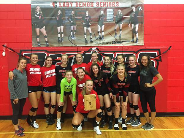 The Glenwood Springs Demons' volleyball team celebrates its win over Steamboat Springs in the Demon Invitational championship game Saturday afternoon at Glenwood Springs High School. (PROVIDED)