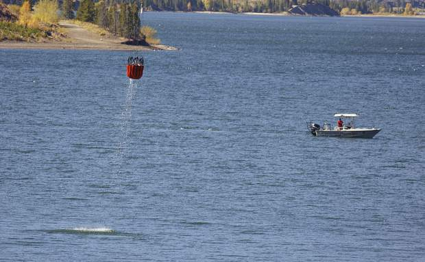 Water buckets refill by helicopter in the Dillon Reservoir to fight the Tenderfoot2 Fire Tuesday, Sept. 19, in Dillon.