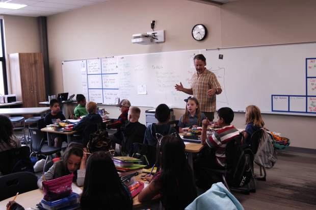 Brian Berg rallies his fourth grade class on the first day of school in the new Glenwood Springs Elementary School digs.