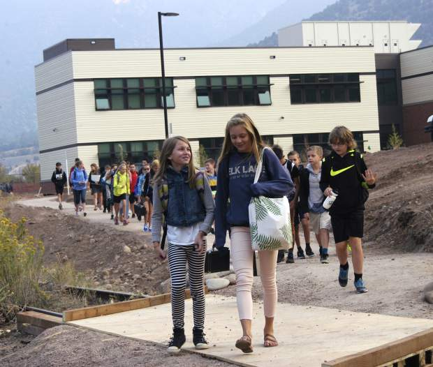 Mykel Backofen, left, and Cate Simpson, both seventh graders, lead a pack of Glenwood Springs Middle School students on the