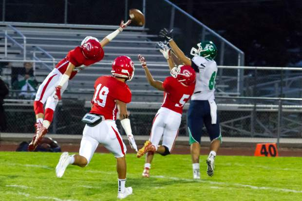 Glenwood Springs Demon Felix Cano makes the interception during Friday night's game against the Kennedy Commanders.