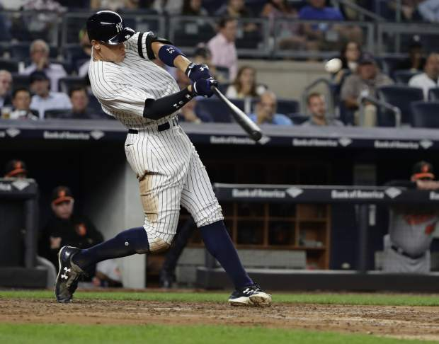 New York Yankees' Aaron Judge hits a three-run home run during a game against the Baltimore Orioles last Thursday, in New York. Nearly two decades after the height of the Steroids Era, Major League Baseball is on track to break its season record for home runs on Tuesday with nearly two weeks left in the season.
