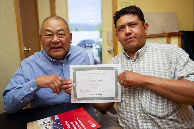Rogerio Ramos, right, and tutor Gary Harada pose with Ramos' certificate of achievement at the English in Action office in El Jebel.