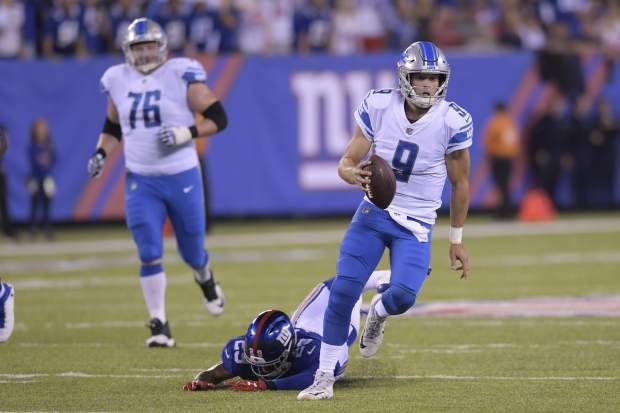 Detroit Lions quarterback Matt Stafford (9) rushes away form New York Giants' Nat Berhe (29) during the first half of an NFL football game Monday, Sept. 18, 2017, in East Rutherford, N.J. (AP Photo/Bill Kostroun)