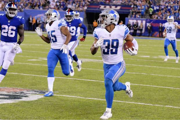 Detroit Lions' Jamal Agnew returns a punt for a touchdown during the second half of an NFL football game against the New York Giants Monday, Sept. 18, 2017, in East Rutherford, N.J. (AP Photo/Bill Kostroun)