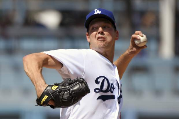Los Angeles Dodgers pitcher Rich Hill throws to the plate during the second inning of a baseball game against the Colorado Rockies, Sunday, Sept. 10, 2017, in Los Angeles. (AP Photo/Michael Owen Baker)