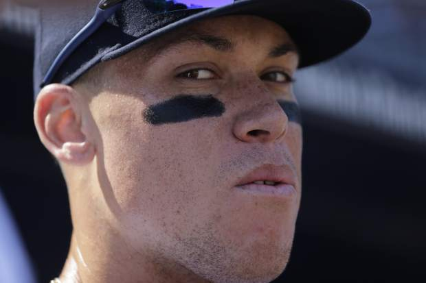 New York Yankees' Aaron Judge in the dugout before a baseball game against the Kansas City Royals at Yankee Stadium, Monday, Sept. 25, 2017, in New York. (AP Photo/Seth Wenig)