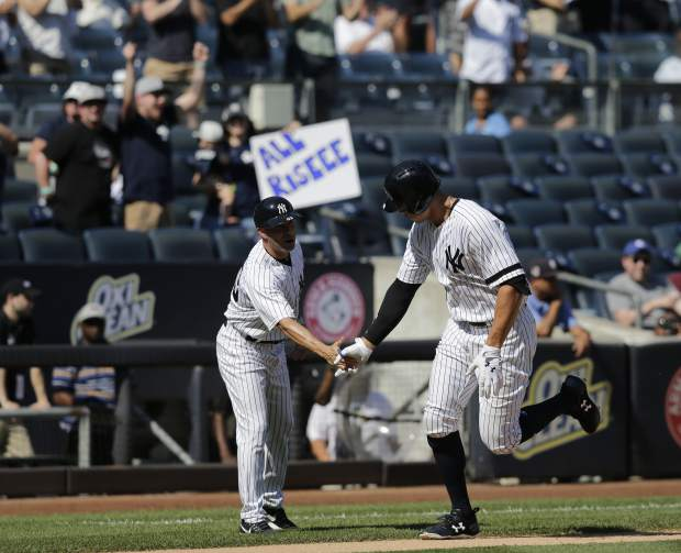 New York Yankees' Aaron Judge, right, reacts as he runs the bases after hitting a two-run homer during the third inning of a baseball game against the Kansas City Royals at Yankee Stadium, Monday, Sept. 25, 2017, in New York. It was Judge's 49th home run, which ties the MLB rookie home run record. (AP Photo/Seth Wenig)
