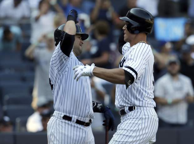 New York Yankees' Aaron Judge, right, celebrates his home run with Gary Sanchez during the seventh inning of a baseball game against the Kansas City Royals at Yankee Stadium, Monday, Sept. 25, 2017, in New York. It was Judge's 50th home run, which sets a new record the most home runs hit by a rookie in the MLB. (AP Photo/Seth Wenig)