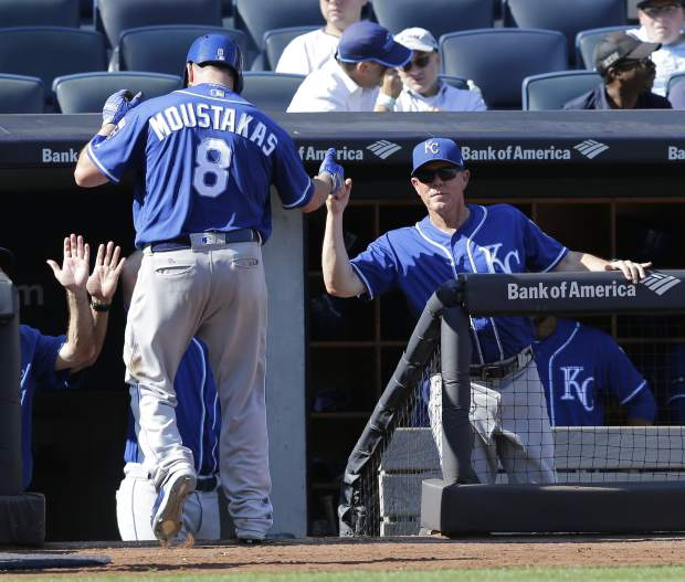 Kansas City Royals manager Ned Yost, right, congratulates Mike Moustakas on his home run during the seventh inning of a baseball game against the New York Yankees at Yankee Stadium, Monday, Sept. 25, 2017, in New York. (AP Photo/Seth Wenig)