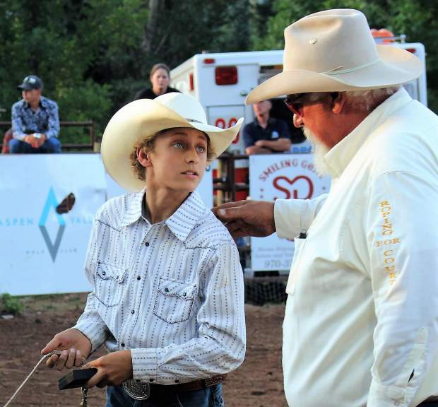 Julie Albrecht of Carbondale wins a $200 Summit Canyon gift card for second place in the Post Independent's 2017 Summer Fun photo contest. Here, Perry Will encourages a young roper at the Carbondale Wild West Rodeo.