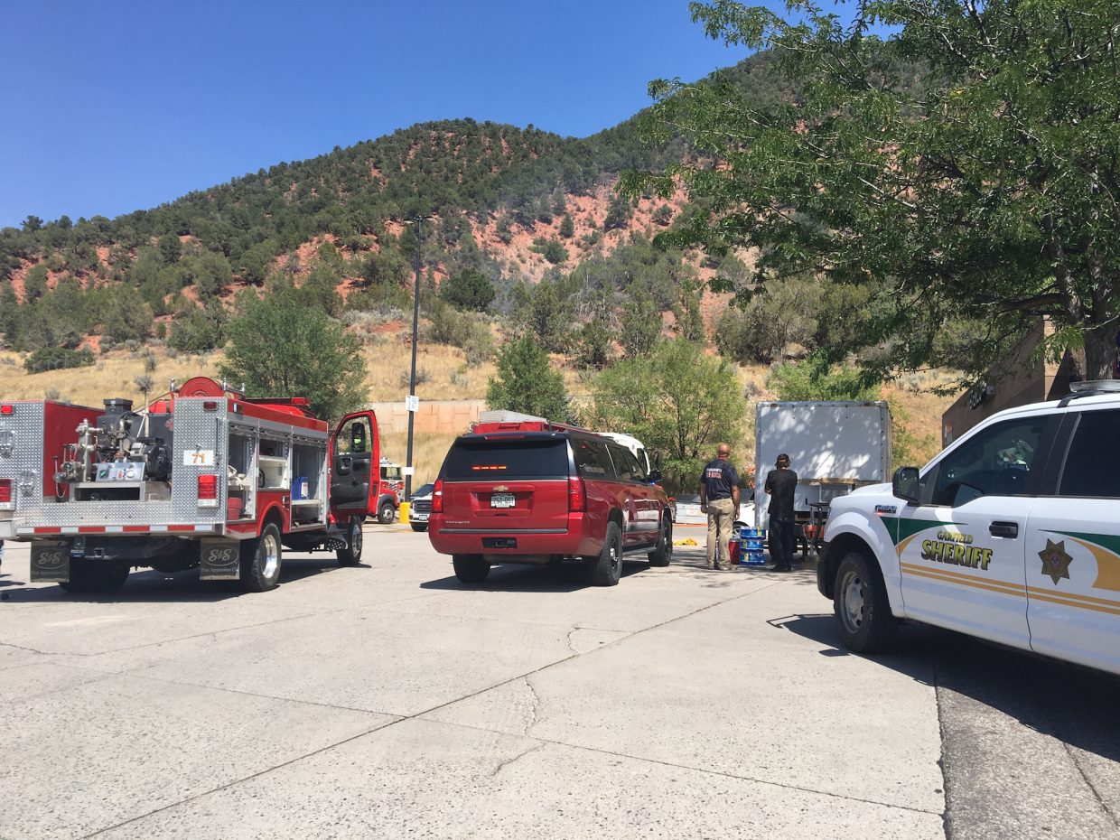 Crews monitor a wildfire that broke out Saturday afternoon on the hillside above Wal-Mart in Glenwood Springs.