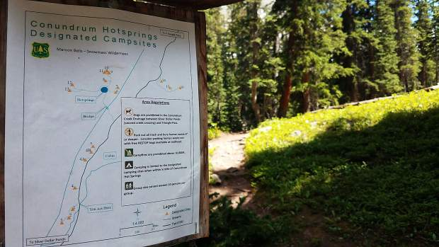 A sign at the Condrum Creek trailhead shows the designated camping around the hot springs.