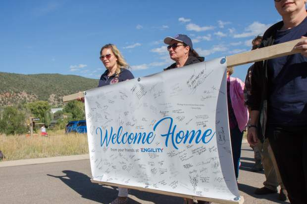 Scenes from the parade prior to the Building Homes for Heroes ceremony and house reveal.