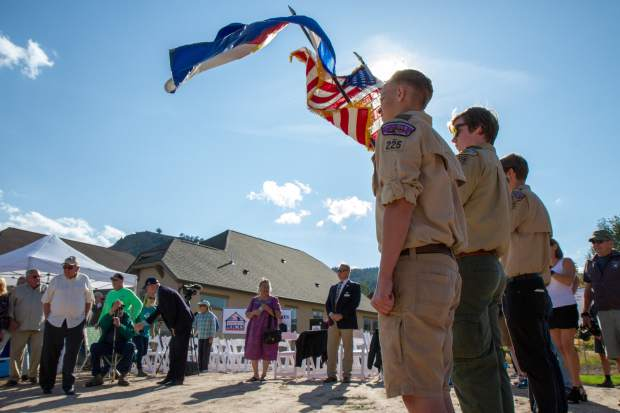 Local Boy Scout Troop 225 present the colors at the Building Homes for Heroes ceremony and house reveal on Saturday evening.