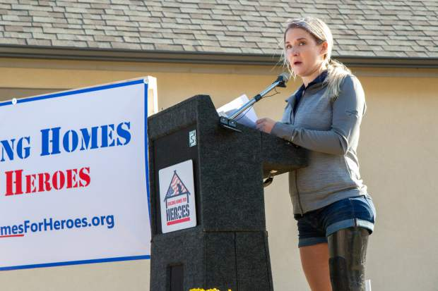 Veteran Sgt. Kirstie Ennis speaks at the Building Homes for Heroes ceremony and house reveal on Saturday evening in Ironbridge.
