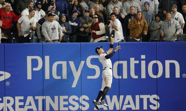 New York Yankees' Aaron Judge makes a leaping catch of a ball hit by Houston Astros' Yuli Gurriel during the fourth inning of Game 3 of baseball's American League Championship Series Monday, Oct. 16, 2017, in New York. (AP Photo/Kathy Willens)