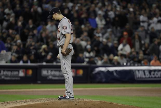 Houston Astros starting pitcher Charlie Morton waits for manager A.J. Hinch to take him out of the game during the fourth inning of Game 3 of baseball's American League Championship Series against the New York Yankees Monday, Oct. 16, 2017, in New York. (AP Photo/David J. Phillip)