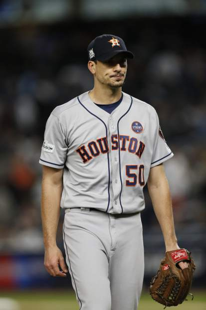 Houston Astros' Charlie Morton walks off the mound after giving up a three run home run to New York Yankees' Todd Frazier during the third inning of Game 3 of baseball's American League Championship Series Monday, Oct. 16, 2017, in New York. (AP Photo/Kathy Willens)