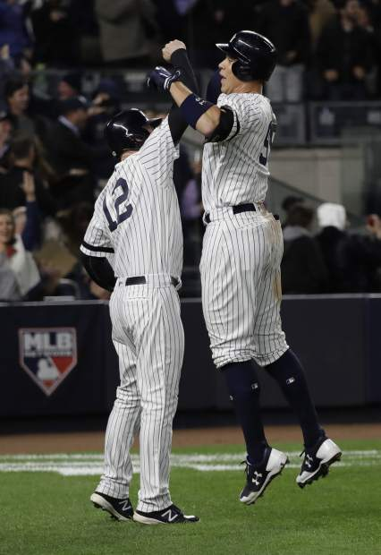 New York Yankees' Aaron Judge celebrates his three-run home run with teammate Chase Headley during the fourth inning of Game 3 of baseball's American League Championship Series against the Houston Astros Monday, Oct. 16, 2017, in New York. (AP Photo/David J. Phillip)