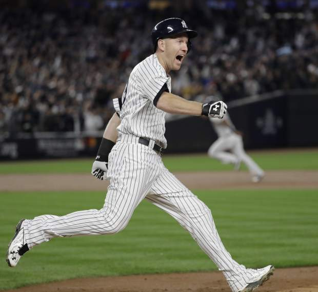 New York Yankees' Todd Frazier reacts after hitting a home run during the third inning of Game 3 of baseball's American League Championship Series against the Houston Astros Monday, Oct. 16, 2017, in New York. (AP Photo/David J. Phillip)