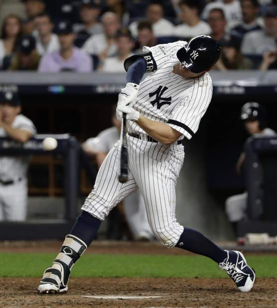 New York Yankees' Greg Bird connects for a solo home run against the Cleveland Indians during the seventh inning in Game 3 of baseball's American League Division Series, Sunday, Oct. 8, 2017, in New York. (AP Photo/Frank Franklin II)