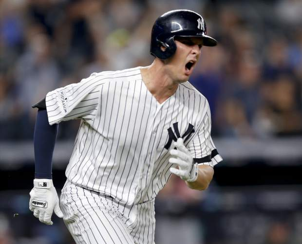 New York Yankees' Greg Bird reacts after hitting a solo home run against the Cleveland Indians during the seventh inning in Game 3 of baseball's American League Division Series, Sunday, Oct. 8, 2017, in New York. (AP Photo/Kathy Willens)