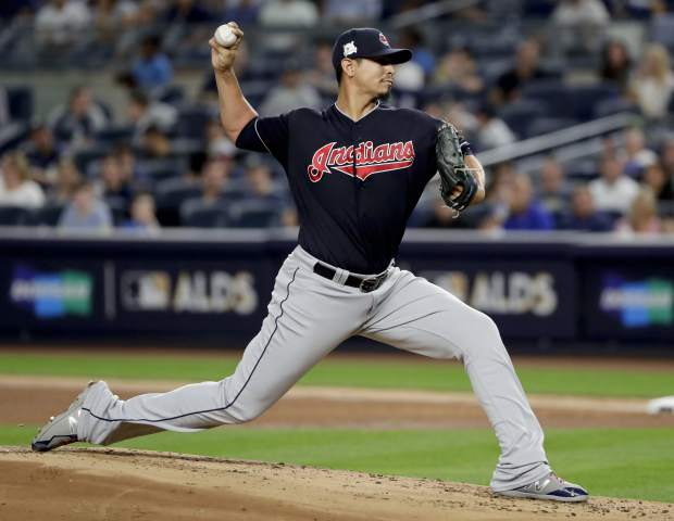 Cleveland Indians pitcher Carlos Carrasco (59) delivers against the New York Yankees during the first inning in Game 3 of baseball's American League Division Series, Sunday, Oct. 8, 2017, in New York. (AP Photo/Frank Franklin II)