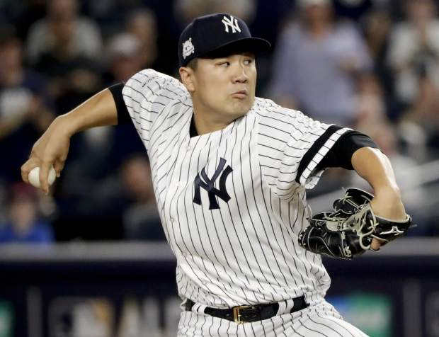 New York Yankees pitcher Masahiro Tanaka (19) delivers against the Cleveland Indians during the first inning in Game 3 of baseball's American League Division Series, Sunday, Oct. 8, 2017, in New York. (AP Photo/Frank Franklin II)