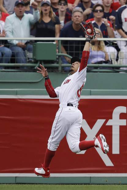 Boston Red Sox right fielder Mookie Betts catches a fly ball hit by Houston Astros Alex Bregman during the third inning of Game 3 of baseball's American League Division Series, Sunday, Oct. 8, 2017, in Boston. (AP Photo/Charles Krupa)