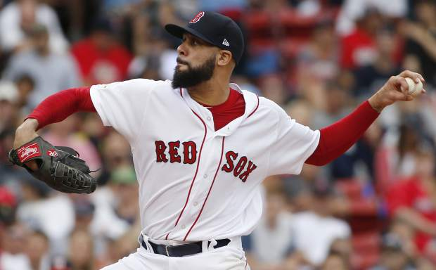 Boston Red Sox relief pitcher David Price delivers against the Houston Astros during the fourth inning in Game 3 of baseball's American League Division Series, Sunday, Oct. 8, 2017, in Boston. (AP Photo/Michael Dwyer)