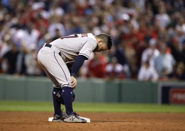 Houston Astros' Jose Altuve stands with head down on second base during the ninth inning of Game 3 of baseball's American League Division Series, Sunday, Oct. 8, 2017, in Boston. The Red Sox won 10-3. (AP Photo/Charles Krupa)