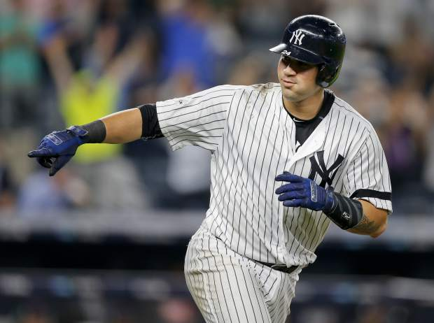 New York Yankees' Gary Sanchez points to the dugout as he rounds the bases after connecting for a solo home run against the Cleveland Indians during the sixth inning in Game 4 of baseball's American League Division Series, Monday, Oct. 9, 2017, in New York. (AP Photo/Kathy Willens)