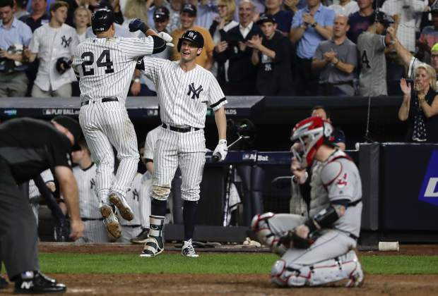 New York Yankees' Gary Sanchez (24) celebrates with Greg Bird after hitting a solo home run against the Cleveland Indians during the sixth inning in Game 4 of baseball's American League Division Series, Monday, Oct. 9, 2017, in New York.(AP Photo/Frank Franklin II)