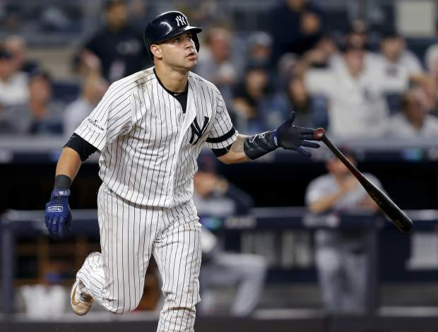 New York Yankees' Gary Sanchez (24) drops his bat after connecting for a solo home run against the Cleveland Indians during the sixth inning in Game 4 of baseball's American League Division Series, Monday, Oct. 9, 2017, in New York. (AP Photo/Kathy Willens)