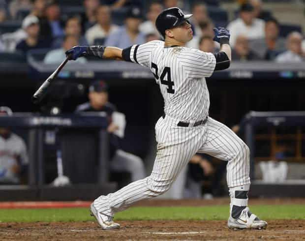 New York Yankees' Gary Sanchez (24) connects for a solo home run against the Cleveland Indians during the sixth inning in Game 4 of baseball's American League Division Series, Monday, Oct. 9, 2017, in New York. (AP Photo/Kathy Willens)