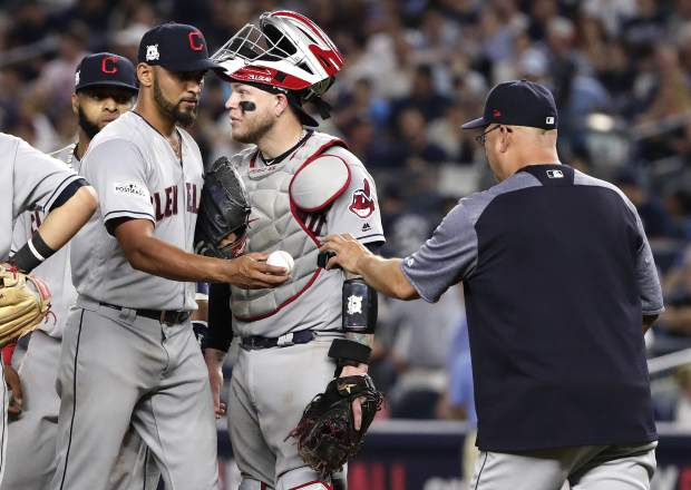 Cleveland Indians pitcher Danny Salazar hands the ball to manager Terry Francona as he leaves the game during the fifth inning in Game 4 of baseball's American League Division Series against the New York Yankees, Monday, Oct. 9, 2017, in New York. (AP Photo/Frank Franklin II)