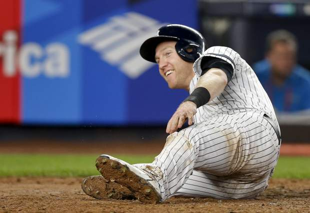 New York Yankees' Todd Frazier after scoring on a sacrifice fly by Brett Gardner during the fifth inning in Game 4 of baseball's American League Division Series, Monday, Oct. 9, 2017, in New York. (AP Photo/Kathy Willens)