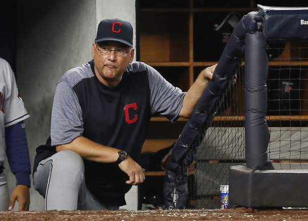 Cleveland Indians manager Terry Francona watches play against the New York Yankees from the dugout in Game 4 of baseball's American League Division Series, Monday, Oct. 9, 2017, in New York. (AP Photo/Kathy Willens)
