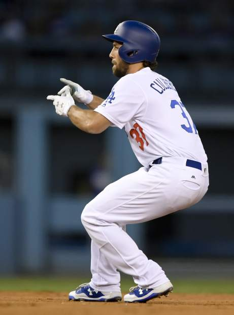Los Angeles Dodgers' Charlie Culberson celebrates after a double against the Chicago Cubs during the fifth inning of Game 2 of baseball's National League Championship Series in Los Angeles, Sunday, Oct. 15, 2017. (AP Photo/Mark J. Terrill)