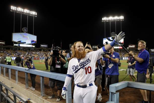 Los Angeles Dodgers' Justin Turner celebrates after a three-run walk off home run against the Chicago Cubs during the ninth inning of Game 2 of baseball's National League Championship Series in Los Angeles, Sunday, Oct. 15, 2017. The Cubs won, 4-1. (AP Photo/Matt Slocum)