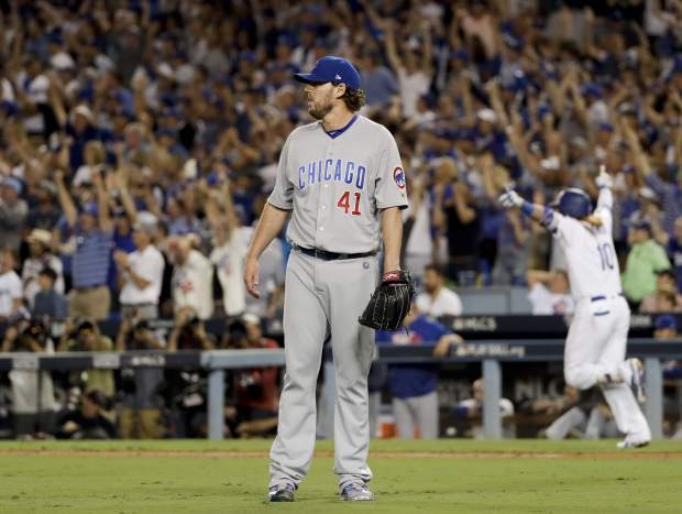 Los Angeles Dodgers' Justin Turner celebrates after a three-run walk off home run off Chicago Cubs starting pitcher John Lackey during the ninth inning of Game 2 of baseball's National League Championship Series in Los Angeles, Sunday, Oct. 15, 2017. The Dodgers won, 4-1. (AP Photo/Matt Slocum)