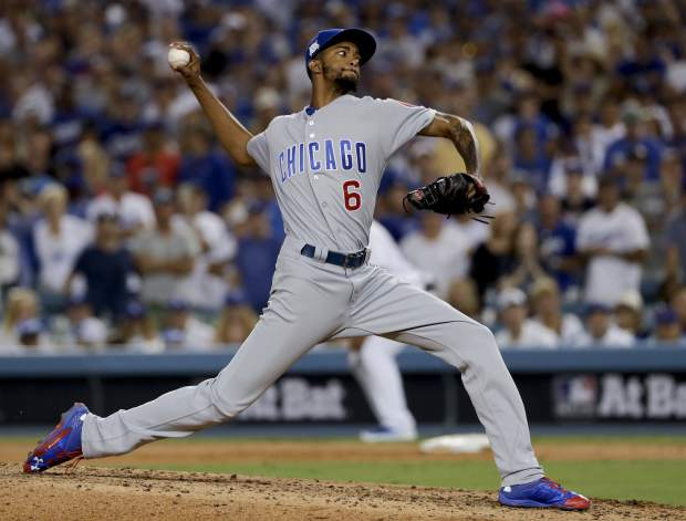 Chicago Cubs relief pitcher Carl Edwards Jr. throws against the Los Angeles Dodgers during the fifth inning of Game 2 of baseball's National League Championship Series in Los Angeles, Sunday, Oct. 15, 2017. (AP Photo/Matt Slocum)