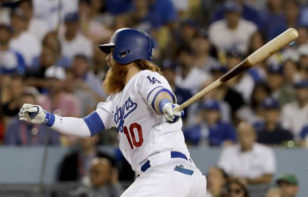 Los Angeles Dodgers' Justin Turner watches his RBI-single against the Chicago Cubs during the fifth inning of Game 2 of baseball's National League Championship Series in Los Angeles, Sunday, Oct. 15, 2017. (AP Photo/Matt Slocum)