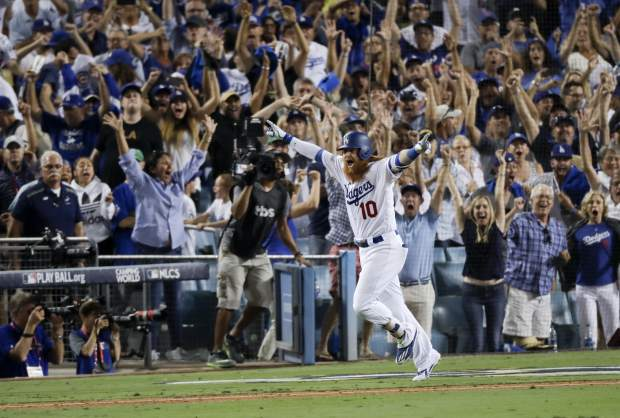 Los Angeles Dodgers' Justin Turner celebrates after a three-run walk off home run against the Chicago Cubs during the ninth inning of Game 2 of baseball's National League Championship Series in Los Angeles, Sunday, Oct. 15, 2017. The Cubs won, 4-1. (AP Photo/Alex Gallardo)