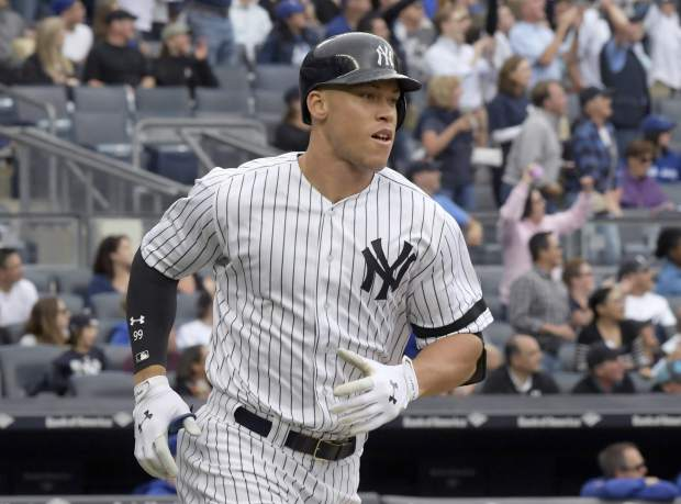 New York Yankees' Aaron Judge rounds the bases with a home run during the fourth inning of a baseball game against the Toronto Blue Jays, Saturday, Sept.30, 2017, at Yankee Stadium in New York. (AP Photo/Bill Kostroun)