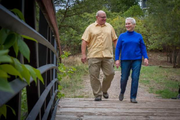 Cathy and husband John Jensen walk on the bike path near their home in South Glenwood after recently moving back to the valley from California. Cathy was the first graduate from Colorado Mountain College.